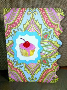 Jolee's Boutique 3D cupcake sticker, Sizzix Framelits dies and the patterned paper came off a pad I picked up at Ross many years ago ... it came pre-die cut with the decorative edge.