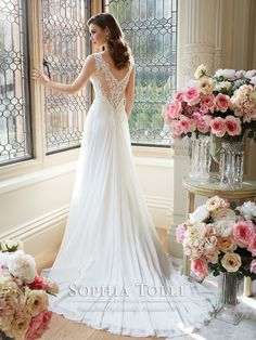 Sophia Tolli - Y11633 – Augusta - Sleeveless angel chiffon slim A-line wedding gown, lace trimmed shoulder straps and plunging V-neckline subtly conceal sweetheart hand-beaded lace appliqué bodice with beaded natural waist, semi sheer V-back with lace appliqués and back zipper both trimmed with diamante buttons, top layer of chiffon skirt features center front split, chapel length train.  Sizes: 0 – 24  Colors: Ivory, White
