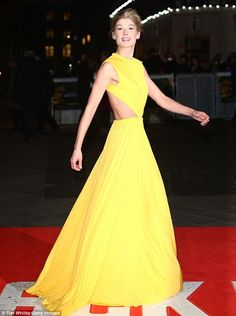 Bringing the sunshine: Rosamund Pike wears a show-stopping Alexander McQueen gown