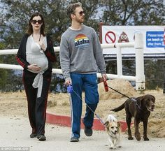 Fun for all the family: It seemed that Anne Hathaway and Adam Schulman were determined to ...