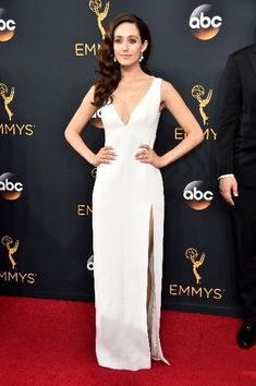 The Shameless star Emmy Rossum wore a plunging white gown by Wes Gordon paired with Brian Atwood shoes at the 68th Annual Primetime Emmy Awards.