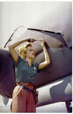 A female Lockheed employee works on a P-38 Lightning, Burbank, CA, 1944.