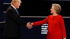 FILE -- Sept. 26, 2016: Republican presidential nominee Donald Trump and Democratic presidential nominee Hillary Clinton shake hands during the presidential debate at Hofstra University in Hempstead, N.Y.