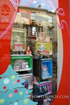 lovely window display - love this idea...already have the wooden wine bottle boxes!!!