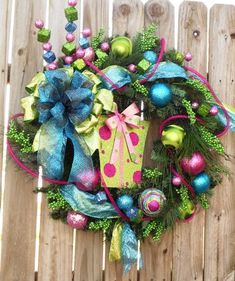 This is a funky fun Christmas wreath filled with lots of bright lime green, hot pink, and vivid blue.