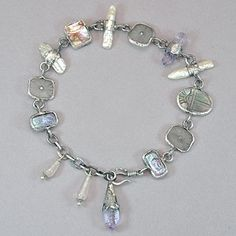 "Tabra One of a Kind Anklet with Carved Mother of Pearl Scarab.  One of a kind, hand made, sterling silver anklet by Tabra. Featuring a carved mother of pearl scarab, amethyst crystal, pearl, carved crystal, paua shell, and rose quartz beads. Length adjustable from 8 1/4"" to 9 3/4""."
