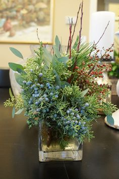 Winter Wreaths and Arrangements - FineGardening Holiday arrangements make Garden Photo of the Day. Christmas Planters, Christmas Greenery, Decoration Christmas, Christmas Flowers, Winter Flowers, Christmas Centerpieces, Outdoor Christmas, Xmas Decorations, Christmas Wreaths