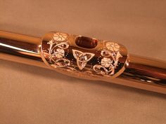 flowers and celtic knot engraved flute embouchure plate. this is beautiful but i think the texture would distract me