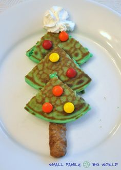 Here is how to make your Christmas tree pancake: 1. Add green food coloring to your pancake batter 2. Create one large round pancake 3. Cut the pancake in 4 equal parts 4. Arrange pancake triangles like a tree 5. Add a sausage tree trunk 6. Add your tree decorations.  We used M&M's for ornaments and whipped cream