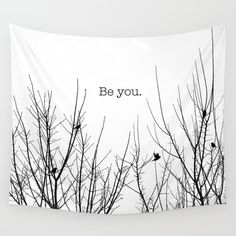 "Inspirational Quote ""Be You"" with black and white birds on branches."