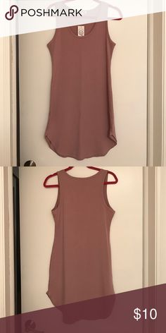 NWT tunic dress Re-posh. Too small on me. Tag says L buts fits a M. This dress it fitted. Worn as a dress or with leggings. Very pretty color! Wish it fit me! The color is a blush pink Dresses