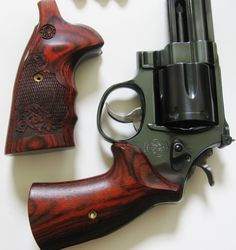 Smith and Wesson mdl 29 Classic with Ahrends grips also Smith and Wesson Logo Grips in Rosewood are available in our store!     http://stores.ebay.com/gcesports/