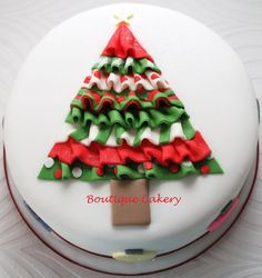 A ruffled Christmas tree cake that I made for a charity event.