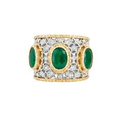 Wide Two-Color Gold, Emerald and Diamond Band Ring, Mario Buccellati  18 kt., the pierced white gold band ring centering 3 oval emeralds, within finely textured yellow gold, accented by small round diamonds, the reverse of finely ribbed white gold, edged by finely textured yellow gold, signed M. Buccellati, approximately 9 dwts