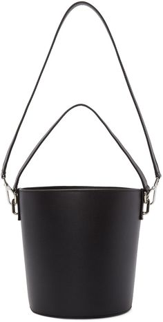 Structured lightly grained leather bucket bag in black. Carry handle at top. Detachable shoulder strap with lanyard clasp fastening. Structured Bag, Unique Purses, Black Leather Handbags, Market Bag, Vintage Accessories, Backpack Bags, Purses And Handbags, Shoulder Strap, Bucket Bags