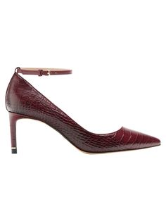 Burgundy, asymmetric high heel court shoes made of embossed mock croc leather. Ankle strap detail with a metal buckle. Leather lining and insole.