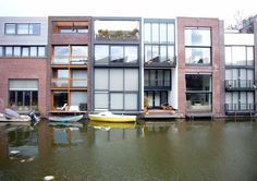 Borneo Sporenburg – Houses  Amsterdam Harbour area – various architects including housing by Enric Miralles (EMBT) & two houses by MVRDV  Photos © Adrian Welch  Borneo houses – photographs from canal side: