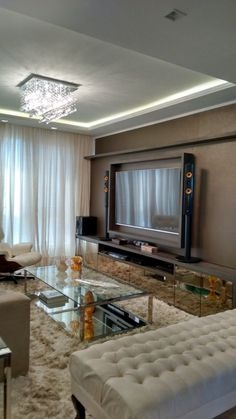 Projeto de reforma, design de interiores e iluminação. Sala de Estar / Home Theater