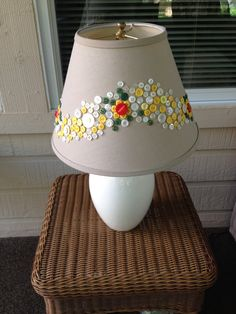Button lampshade. Hot glue and a vision. 'Nuff said.