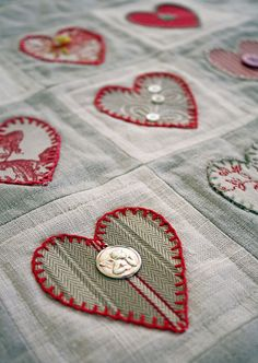 Appliqued hearts by Jill Burgess | Bailiwick Studio. Blanket stitching around the hearts; buttons.