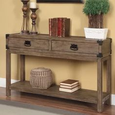Add this unique Console table to your home. The table offers a warm. homey feel with its Carmel Burnished Natural finish and a rustic charm with its black metal accents. The table features two drawers and a bottom shelf for your storage and display needs Living Room Furniture, Home Furniture, Accent Furniture, Beach Furniture, Furniture Buyers, Furniture Cleaning, Table Furniture, Furniture Design, Rustic Console Tables