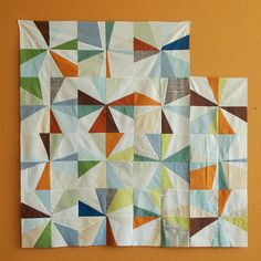 quilt! makes me want to get a whole bunch of solids and stripes and checks and make one too