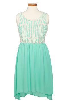 A sea green high-low dress