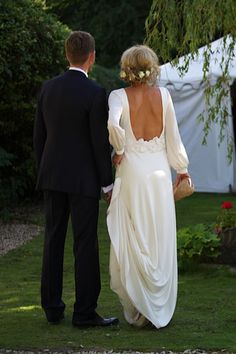 Long sleeve backless wedding gown by Delphine Manivet, perfect for a boho wedding.
