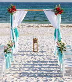 beach Wedding Bamboo Arbor Arch with different colored flowers. Maybe white and pink