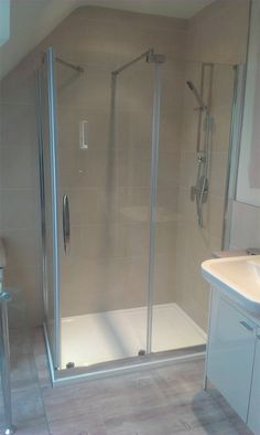 Gym Shower Room by South England Homeowner  Retailer:   The owner of a luxury home was keen to renovate the shower room off their gym. They were aiming for a luxury spa feel with an unfussy design. Featured Products: Desire Sliding Door Shower Enclosure  & Infinity Low Level Shower Tray. Images copyright of Roman Ltd, and protected by Roman Ltd. Please do not remove this description & copyright notice.