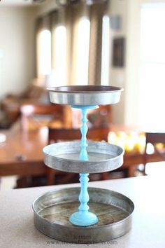 DIY display out of cake pans and candlesticks~Was thinking this would make a cute birdfeeder too!