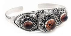 """Gothic Costume Sterling Silver Poison Box Locket Cuff Bracelet with Genuine Amber Silver Insanity. $129.99. Secret Compartment is 5/8"""" diameter. Genuine 10mm Amber Cabachon and Two Accenting Amber Cabachons. Is adjustable and will fit approximately a 7"""" to 8"""" wrist. 1"""" Wide Across the and Tapering to 6mm. Weight is Approximately 21.5 Grams"""
