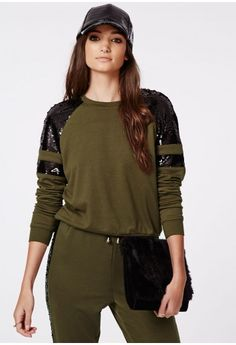 Rock out in this key colour this season with this chic khaki sweater. The stunning black sequin panels over the shoulder and again further down the long sleeve will make heads turn in this jersey jumper top. Team with matching joggers for e...
