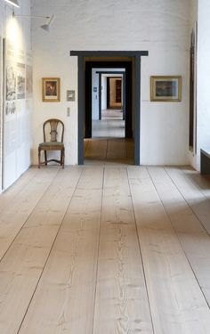 In 1965 Dinesen produced Douglas floor planks for Sønderborg Castle in lengths of up to 15 metres and widths of up to 45 cm. The result was striking floors that blended naturally into the old building and complimented the castle's original expression. Hallway Flooring, Wide Plank Flooring, Parquet Flooring, Wooden Flooring, Wooden Floors Living Room, Floor Design, House Design, Interior And Exterior, Interior Design