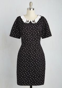 You love playing with outfit combos, but this black, dotted dress seems to style itself! Its white, scalloped collar - with periwinkle-and-pink bird embroidery - lends itself as the star of all sorts of standout ensembles you never knew you'd flaunt.