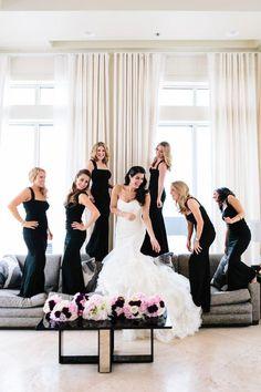 Bridesmaids in elegant black full length dresses