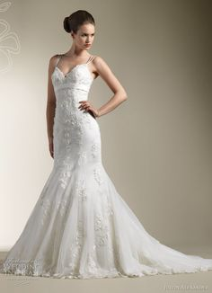 Beaded venice lace mermaid gown with dual spaghetti straps,  sweetheart neckline with bias band at the empire waist.