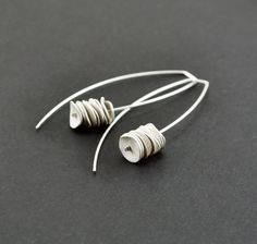 Reticulated sterling silver long dangle earrings. Rustic texture. Minimalist earrings. Contemporary jewelry by mariagotijoyas on Etsy https://www.etsy.com/listing/126312819/reticulated-sterling-silver-long-dangle