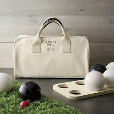 Beautiful bocce ball set features smartly etched solid resin balls and a neat naturally colored canvas carrying bag to tote them. Set includes a score pad, pencils and instructions.