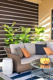 Make your patio or porch feel more like a room with a privacy screen. This DIY slatted privacy screen is both functional and beautiful, giving the patio a cabana-style feel. Learn more about this trend and get the step-by-step. Patio Privacy Screen, Outdoor Privacy, Privacy Screens, Privacy Wall On Deck, Garden Privacy, Backyard Privacy, Outdoor Rooms, Outdoor Living, Outdoor Decor