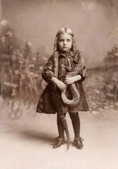 Girl and her snake. Adorable or something.