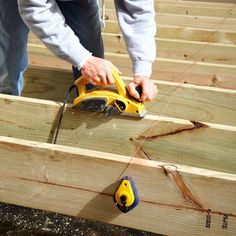 Expert deck builders show you how to install Trex decking like a pro! Get step-by-step instructions (with pictures) & pro tips from our composite deck experts! Deck Building Plans, Deck Plans, Building Stairs, House Building, Building Ideas, Under Deck Roofing, Deck Footings, Concrete Footings, Platform Deck
