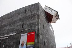 house attack sculpture by erwin wurn museumsquartier vienna, austria