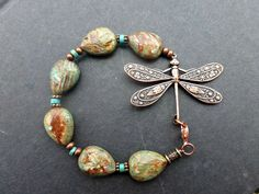This simple and elegant bracelet features an aged brass dragonfly piece, bent gently to follow the wrist. Lobster clasp size 7.0 this can be adjusted to fit any size with notes to seller at checkout.