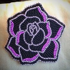 A hair barrette that I beaded for a co-worker for our Christmas gift exchange. A rose, outlined with a metallic lavender, some fuschia, and black beading!!! Carmen Dennis