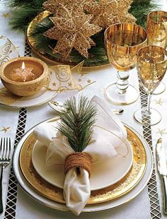 50 Stunning Christmas Tablescapes: This gold and green accented table is beautiful!
