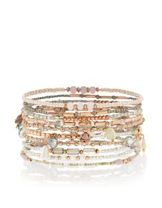 In a set of ten dainty designs, these sparkling stretch bracelets will add a hit of glitz to your look thanks to their mix of faceted gems and gold-tone bead...