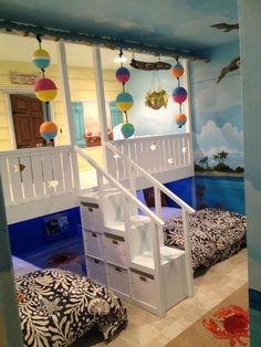 H o w C U T E! We had a custom bedroom beach shack built like this for Nix, but I love the idea of a front porch for a playroom in our future home!