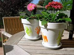 Hand print flower pots. Our Mother's Day gift giving idea.