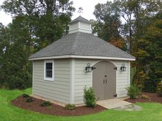 Shed Ideas Arched Doors and hardie siding